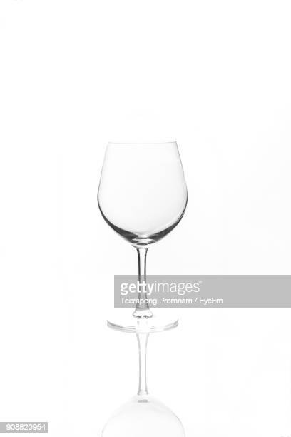 close-up of empty wineglass against white background - wineglass stock pictures, royalty-free photos & images