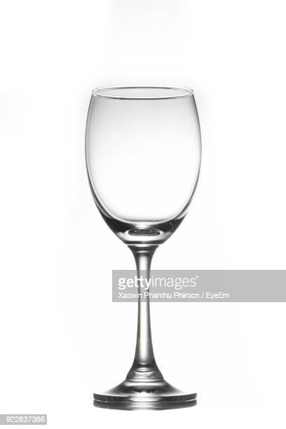 close-up of empty wineglass against white background - wine glass stock pictures, royalty-free photos & images