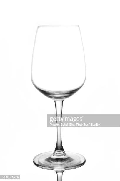 close-up of empty wineglass against white background - wine glass stock photos and pictures