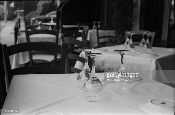 close-up of empty wineglasses and plates on dining table - beverly hills stockfoto's en -beelden