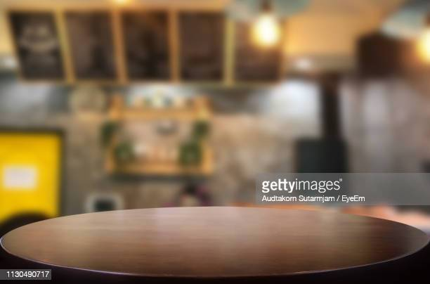 close-up of empty wooden in restaurant - focus on foreground stock pictures, royalty-free photos & images