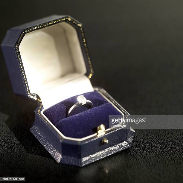 close-up of engagement ring in ring box - engagement ring box stock photos and pictures
