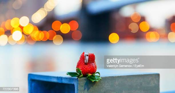 Close-Up Of Engagement Ring On Strawberry