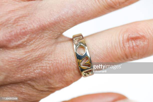 close-up of engagement ring with word love - february stock pictures, royalty-free photos & images
