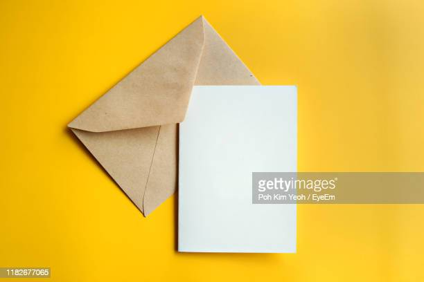 close-up of envelope against yellow background - greeting card stock pictures, royalty-free photos & images