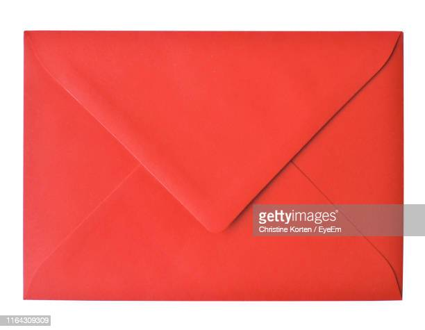 close-up of envelope on white background - envelope stock pictures, royalty-free photos & images
