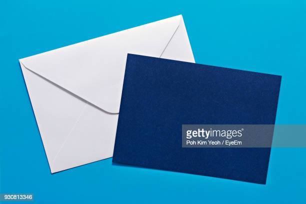 close-up of envelope with blank paper against blue background - greeting card bildbanksfoton och bilder