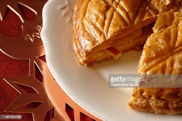 close-up of epiphany cake - galette des rois photos et images de collection
