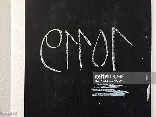 Close-Up Of Error Written On Blackboard