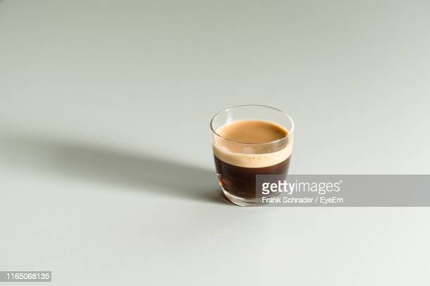 close-up of espresso in cup on table - frank schrader stock pictures, royalty-free photos & images