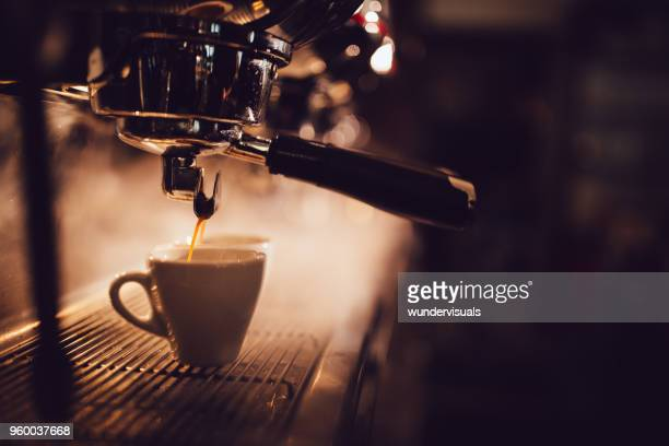 close-up of espresso machine brewing a cup of coffee - coffee stock photos and pictures