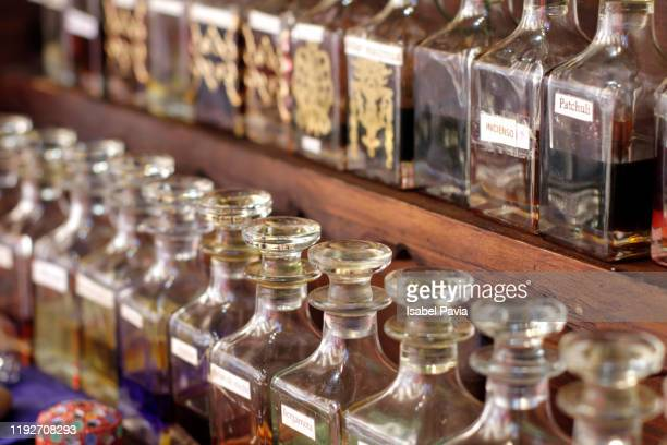 close-up of essential oils in a row - aromatherapy oil stock pictures, royalty-free photos & images