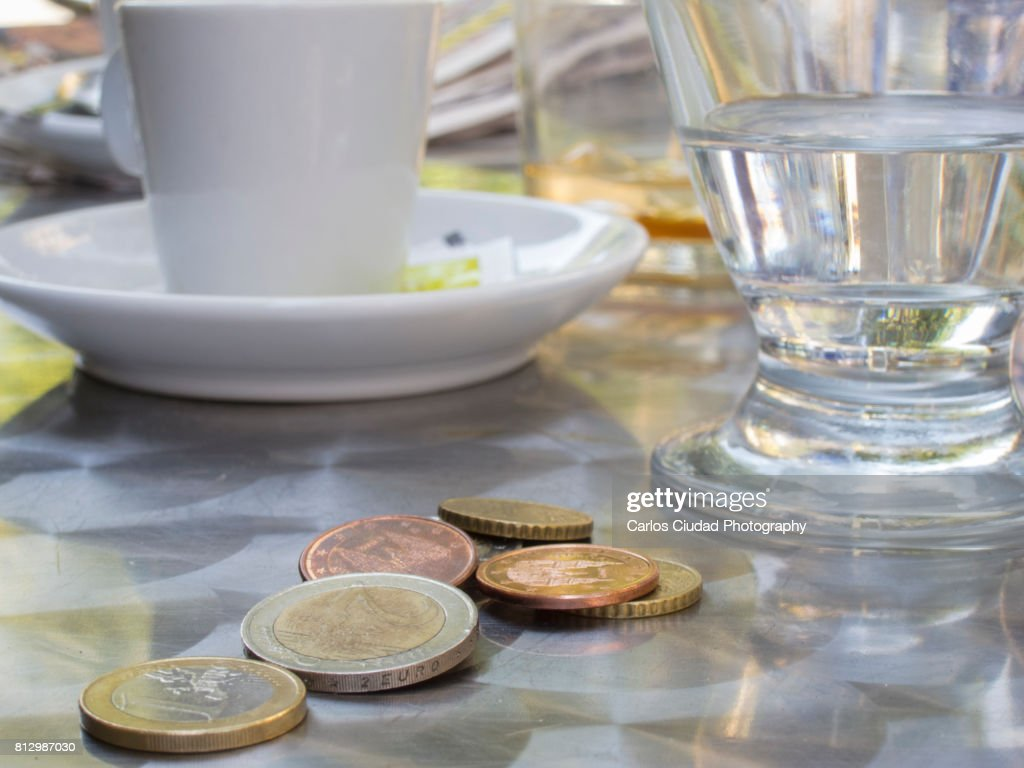 Close-up of euro coins on table in a Spanish restaurant : Stock Photo
