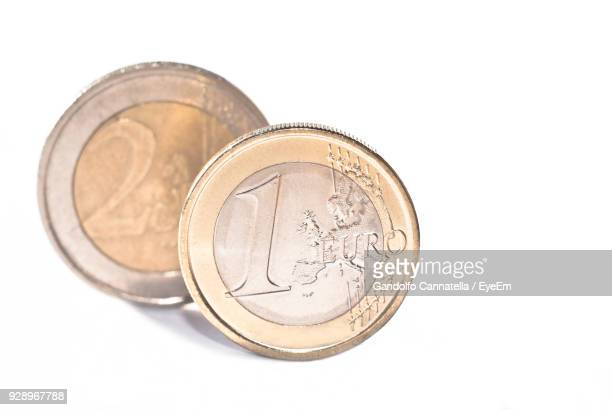Close-Up Of Euro Coins On White Background