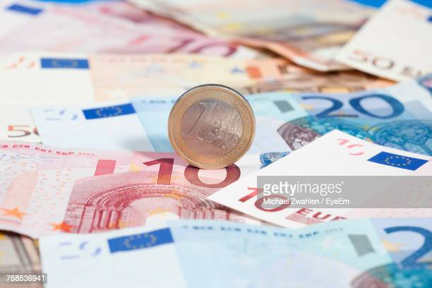 close-up of euro notes and coin - twenty euro banknote stock photos and pictures