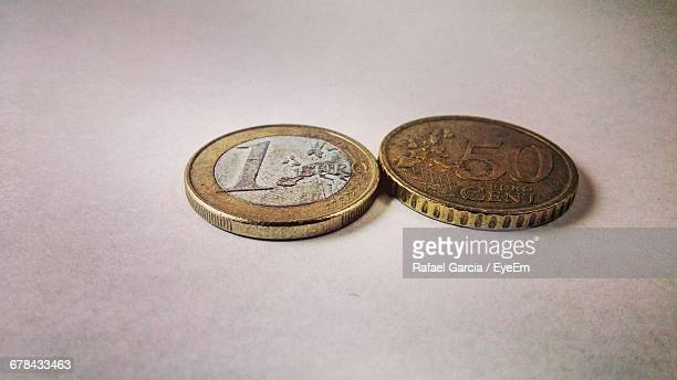 Close-Up Of European Union Coins On Table