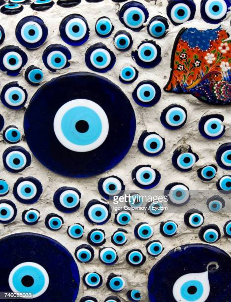 close-up of evil eye beads on wall - evil stock pictures, royalty-free photos & images