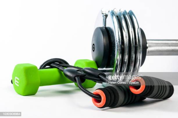 close-up of exercise equipment over white background - exercise equipment stock pictures, royalty-free photos & images