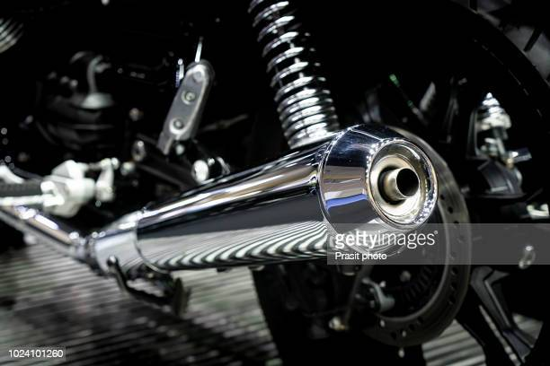 closeup of exhaust or intake of racing motorcycle. low angle photograph of motorcycle. - {{asset.href}} stock-fotos und bilder