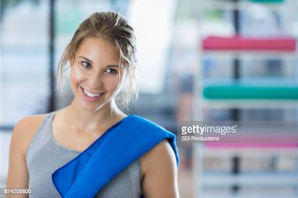 closeup of exhausted young woman relaxing after workout - humility stock pictures, royalty-free photos & images