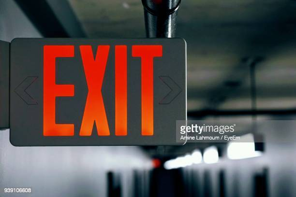 close-up of exit sign in corridor - exit sign stock pictures, royalty-free photos & images