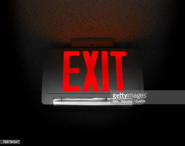 Close-Up Of Exit Sign On Black Background