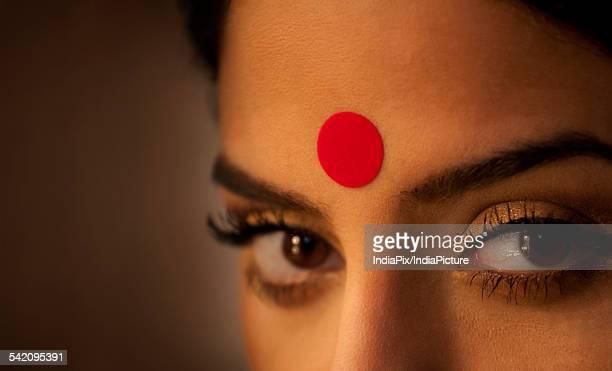 Close-up of eye and bindi of a woman