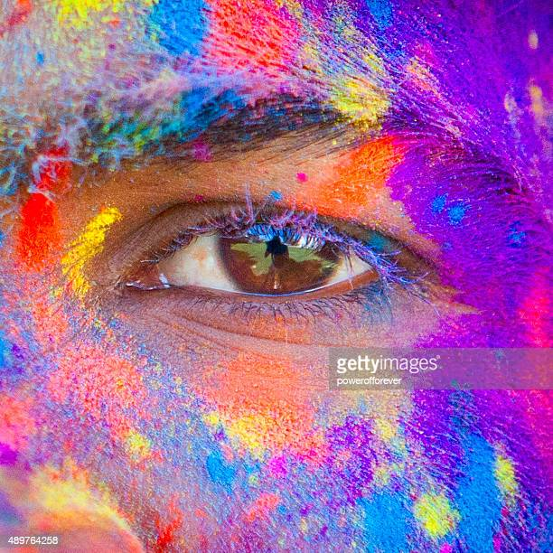 close-up of eye at holi festival - holi stock pictures, royalty-free photos & images
