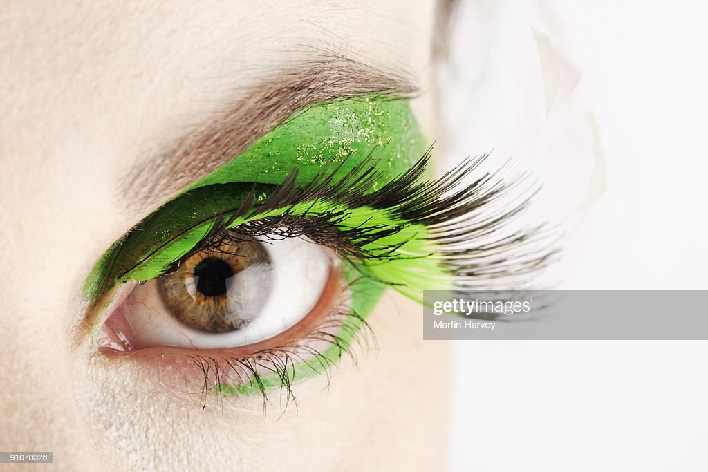Close-up of eye with green make-up. : Stock Photo