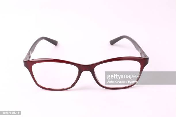 close-up of eyeglasses against white background - reading glasses stock pictures, royalty-free photos & images