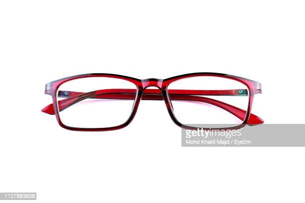 close-up of eyeglasses against white background - eyewear stock pictures, royalty-free photos & images