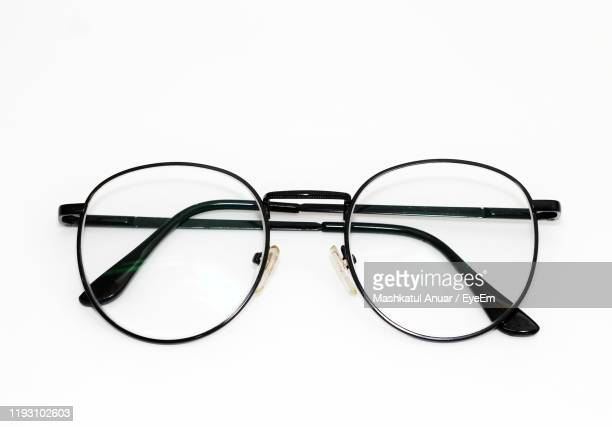 close-up of eyeglasses against white background - めがね類 ストックフォトと画像