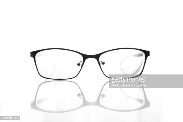 close-up of eyeglasses against white background - めがね ストックフォトと画像
