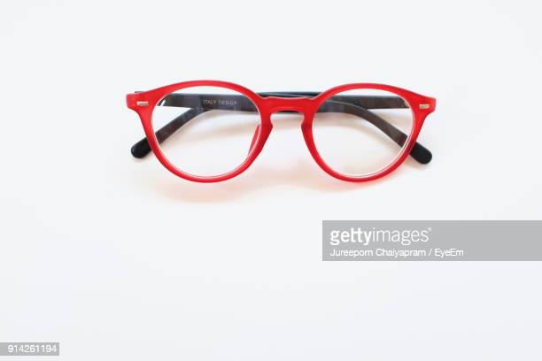 close-up of eyeglasses against white background - eyeglasses stock pictures, royalty-free photos & images