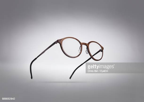 close-up of eyeglasses against white background - occhiali da vista foto e immagini stock