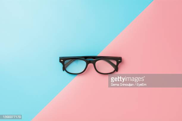 close-up of eyeglasses on colored background - two tone color stock pictures, royalty-free photos & images