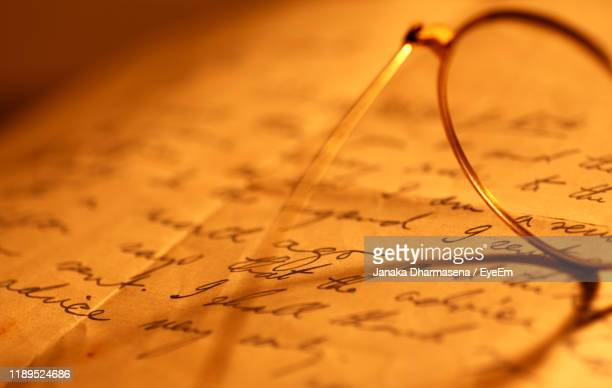 close-up of eyeglasses on paper - manuscript stock pictures, royalty-free photos & images