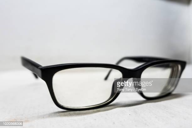 close-up of eyeglasses on table - west kalimantan stock pictures, royalty-free photos & images
