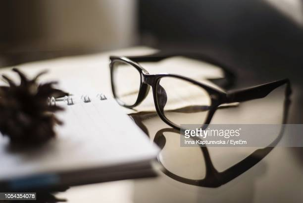 close-up of eyeglasses on table - reading glasses stock pictures, royalty-free photos & images