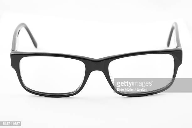 Close-Up Of Eyeglasses Over White Background