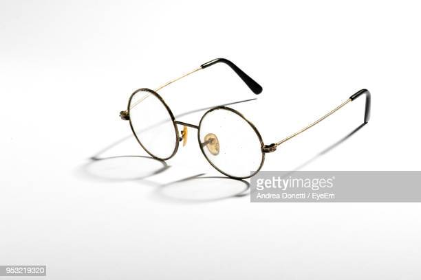 close-up of eyeglasses over white background - めがね ストックフォトと画像