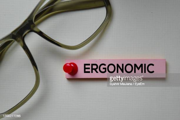 close-up of eyeglasses with text on textile - 人間工学 ストックフォトと画像