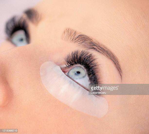 close-up of eyelash extension on young woman - stock photo - false eyelash stock pictures, royalty-free photos & images