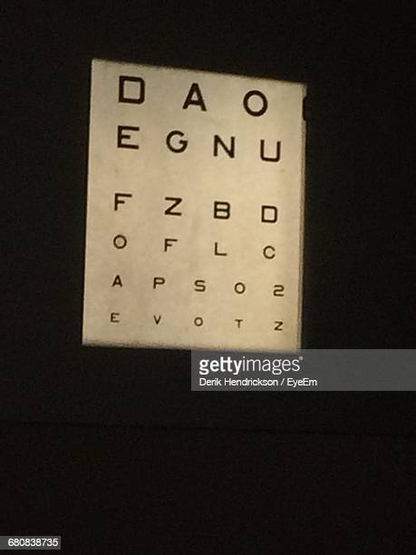 close-up of eyesight test chart on wall - eye chart stock photos and pictures