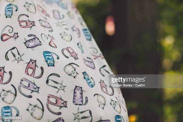 close-up of fabric against trees in yard - bortes stock pictures, royalty-free photos & images