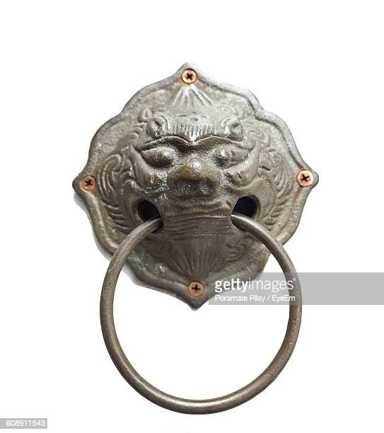 close-up of face carving door knocker white background - door knocker stock photos and pictures