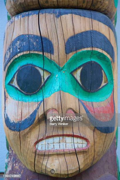 close-up of face in totem, juneau - barry wood stock pictures, royalty-free photos & images
