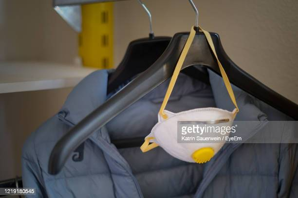 close-up of face protection mask hanging on coathanger - funny surgical masks stock pictures, royalty-free photos & images