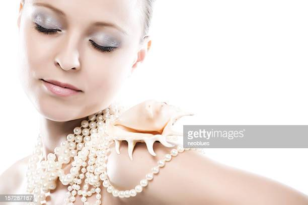 Close-up von Gesicht mit cockle shell-Technologie und Perlen