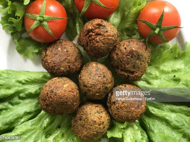 Close-Up Of Falafels With Cherry Tomatoes And Lettuce In Plate